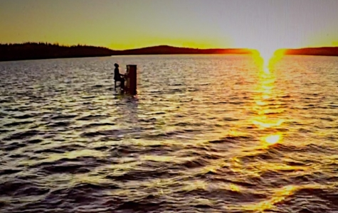 Jeffery Straker playing a floating piano out on Reindeer Lake in Northern Saskatchewan